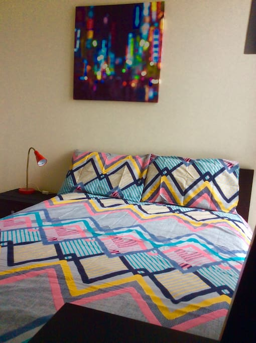 Clean  room equipped with double bed, built in robe, laptop area