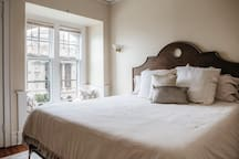 Tempurpedic King Bed overlooking Wisconsin Ave! Perfect window seat to house your suitcases off the floor!