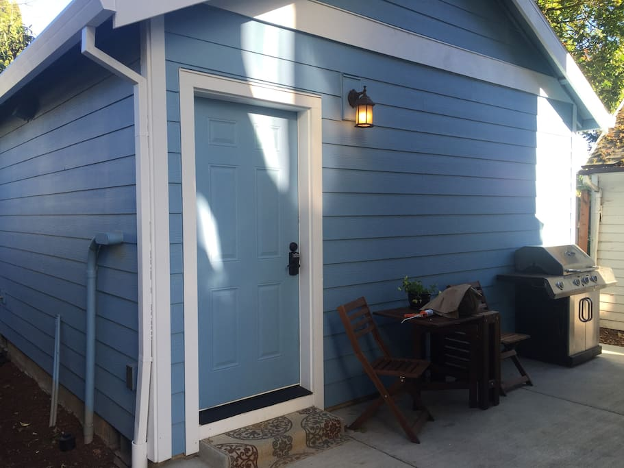 Brand new tiny house features patio and infrared grill for guests to use during their stay!