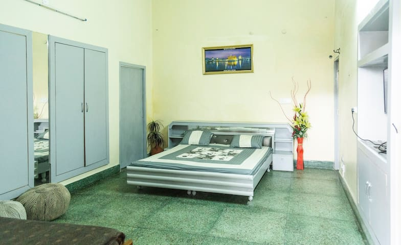 Master bedroom with 3 beds