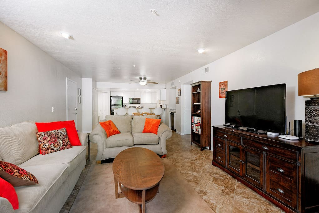 """Open-concept living area with 50"""" flat screen TV. Complimentary Wi-Fi provided."""