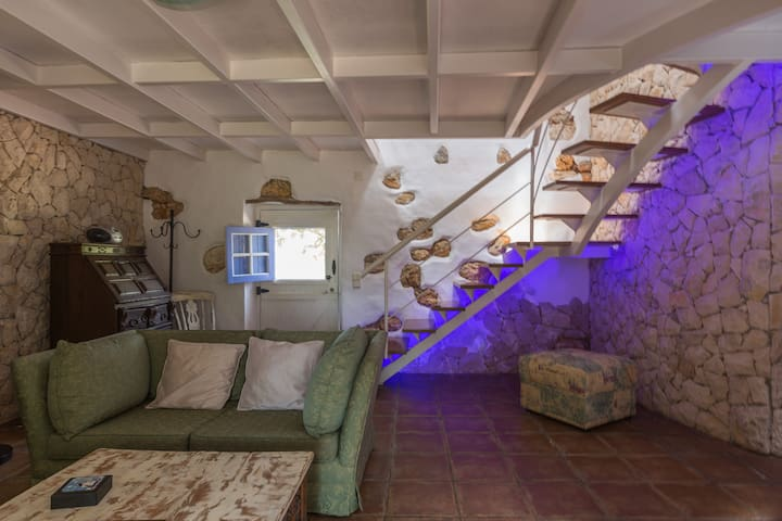 Lounge and stairs leading to mezzaine .