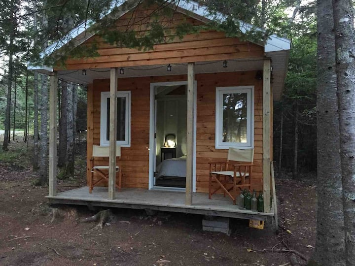 Cozy sleeping bunkie at intimate camp site