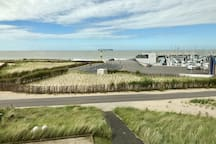 View from appt over the dunes and to the harbour and 1* Michelin restaurant Air Republic by Sergio Hermans