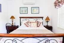 Comfortable bed ,  nice bedside tables and lamps plus  pretty artwork as a nice accent
