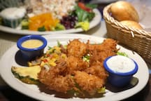 We recommend the coconut breaded shrimp at the The Conch Republic - just a 3 minute walk away on Gulf Boulevard!