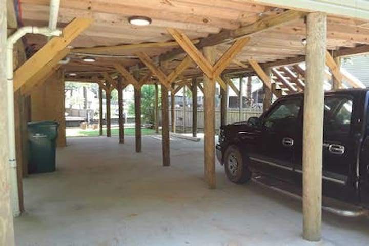 Under camp. Perfect for entertaining,  cooking, or parking. Overlooks river.