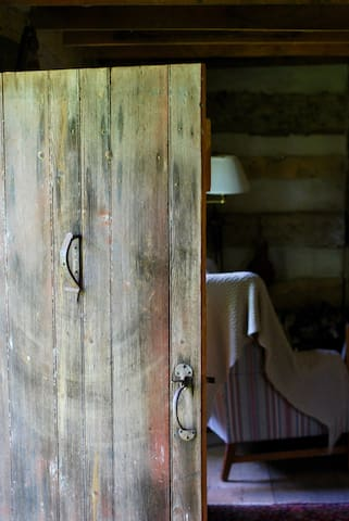 We love the cabin's patina-ed details, like the iron hardware on the front door.
