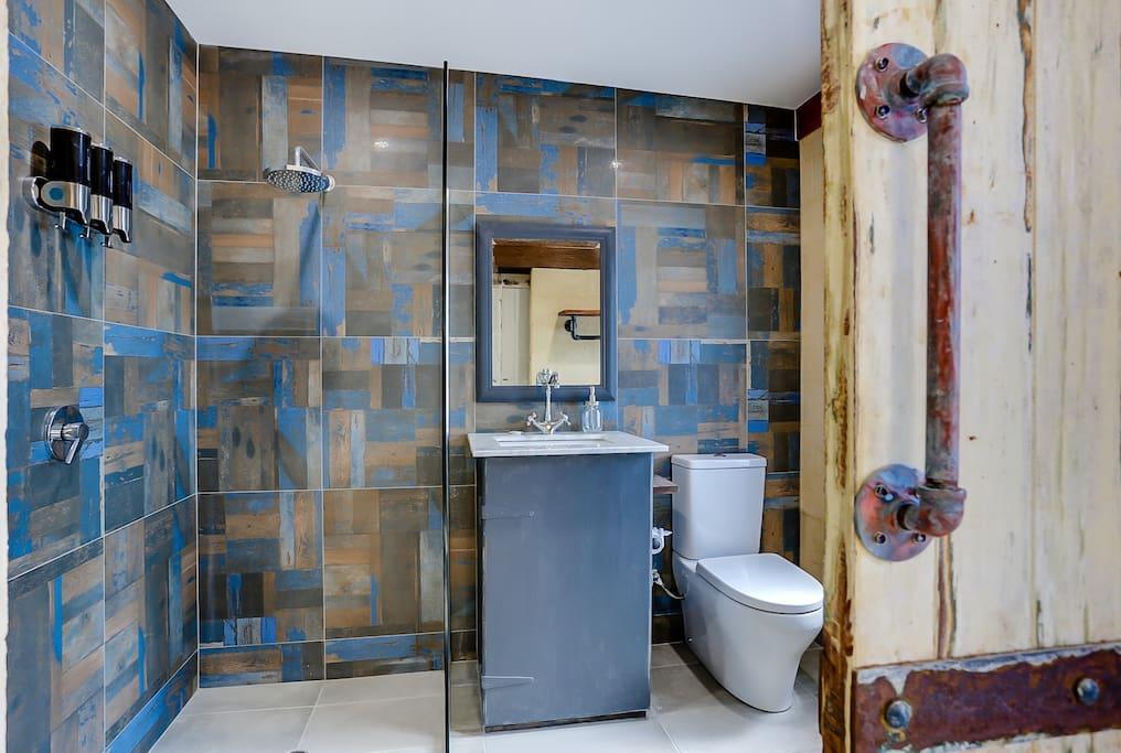 The rustic barn door makes for a grand bathroom entrance