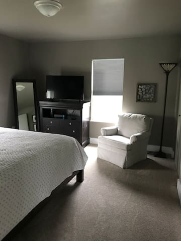 The master bedroom has it's own television and a view of the herb and vegetable garden.