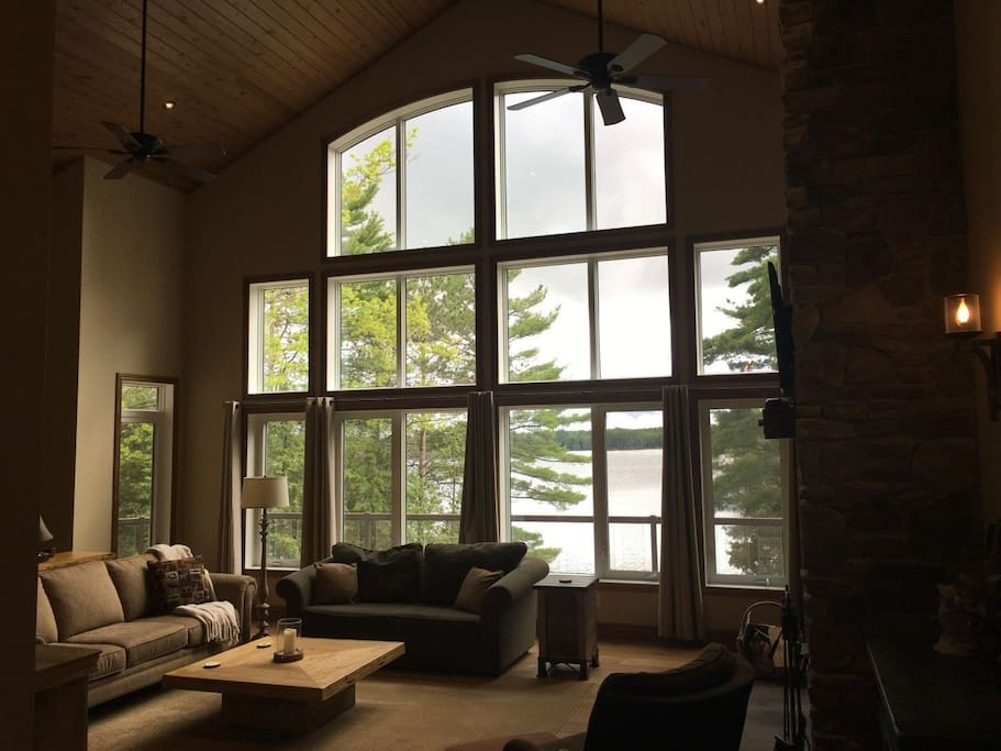 Great room with comfortable seating and a giant wall of windows bring the outdoor scenery inside.