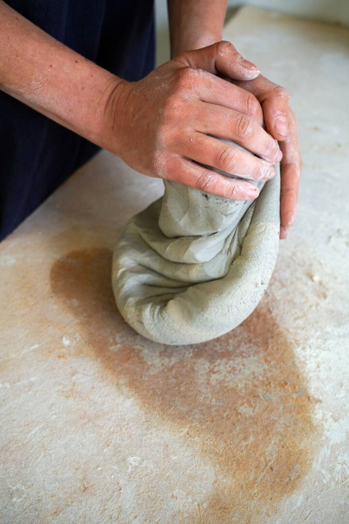 kneading the clay