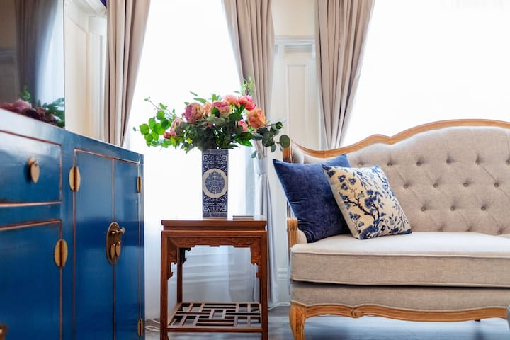 Living room: couch, carved coffee table and chinoiserie chest
