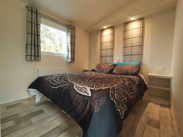 The master bedroom with a comfy queen bed