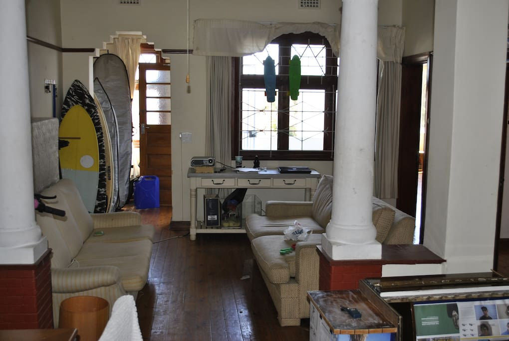 Main lounge area with surfboard rack