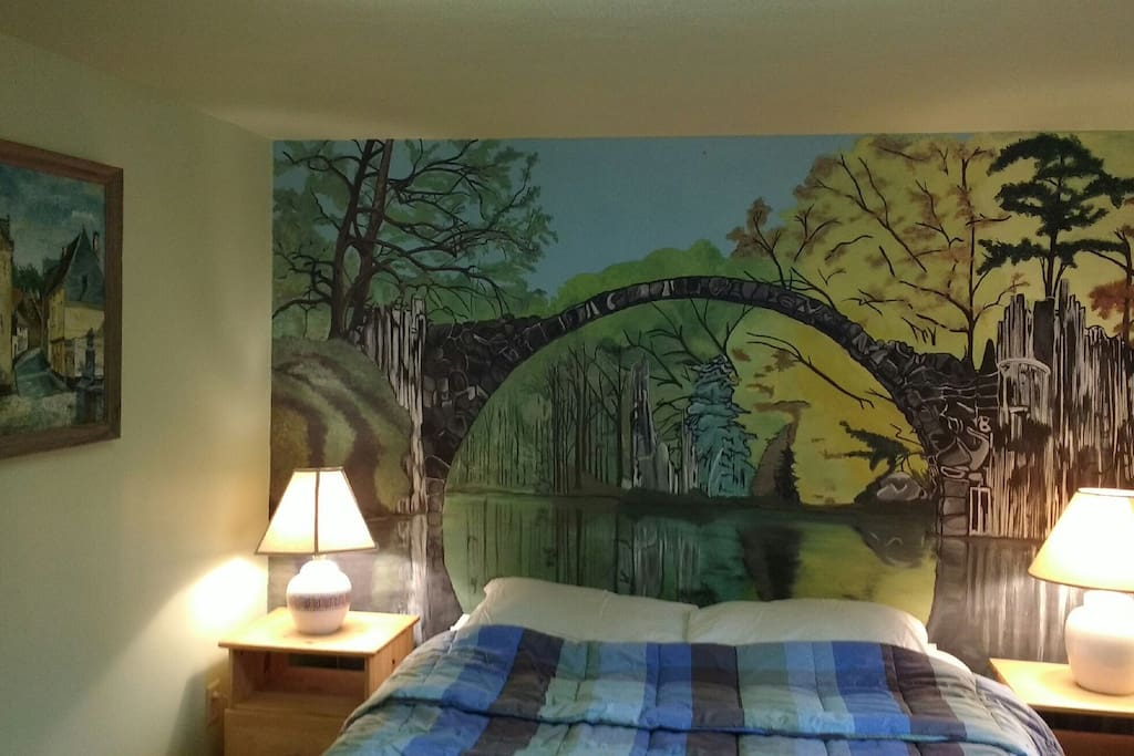 Bedroom has a beautiful mural and comfy bed. There's also a large closet for you.