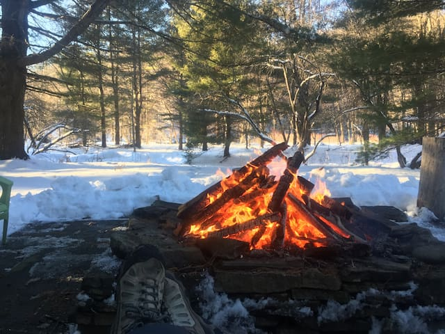 Modern riverside retreat with firepit.