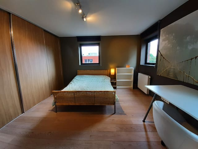Big room in penthouse with free parking space