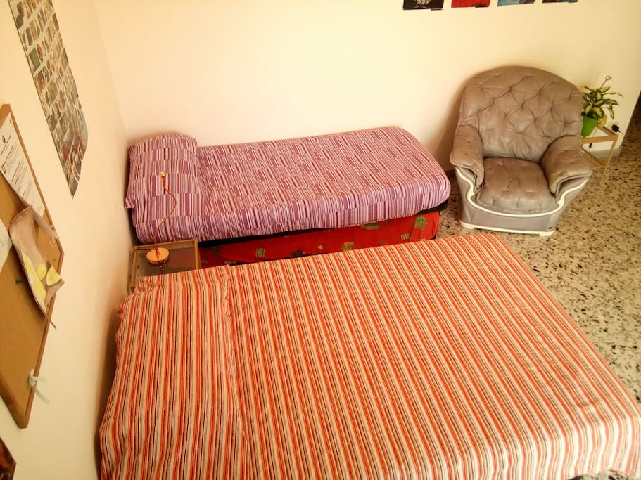 The room is equipped with a queen-size bed plus a single bed. A third bed can be added.