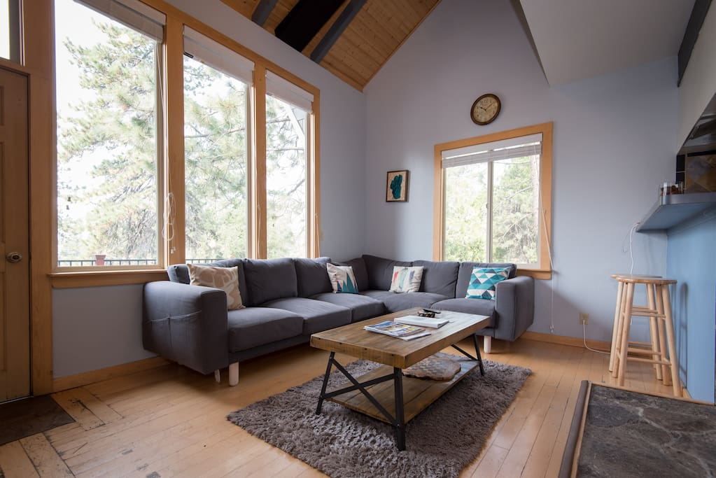 Living room with picture windows and L couch