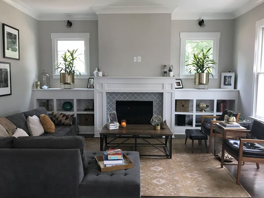 Living room with fireplace and lots of natural light.