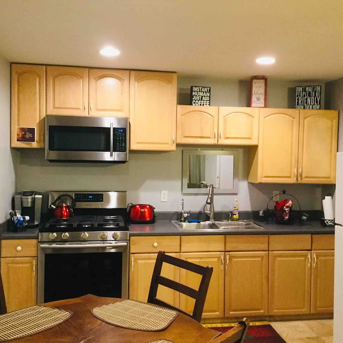 Full equipped kitchen with all you need to prepare your own meals, with brand new Stove and Microwave.