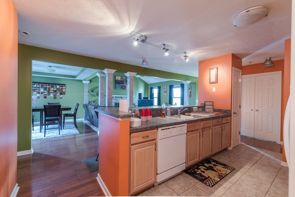 The kitchen opens up to the family room allowing the cook to interact with other guests. dishwasher, fridge, microwave, coffee maker, and stove. Equipped with plastic ware, hand soap, and dish liquid. Some cups, plates, and cook ware available.