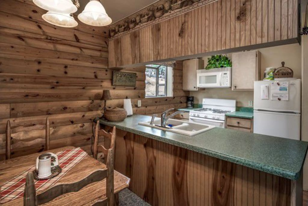 Full service kitchen; dining room has fold-up roll-away twin bed.