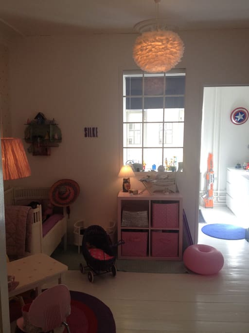 Girl room with bed and toys