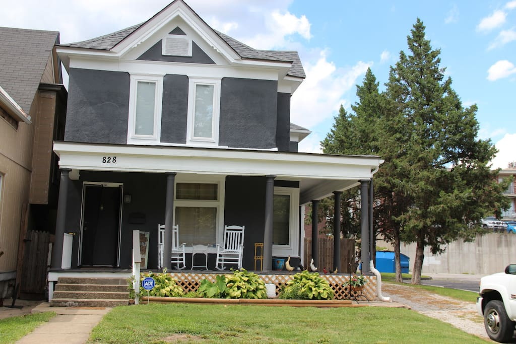 Front of house with long driveway for parking. Large wrap around porch facing Ann Avenue.