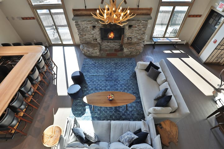 The great room features your own private bar, fireplace, and cozy seating area!