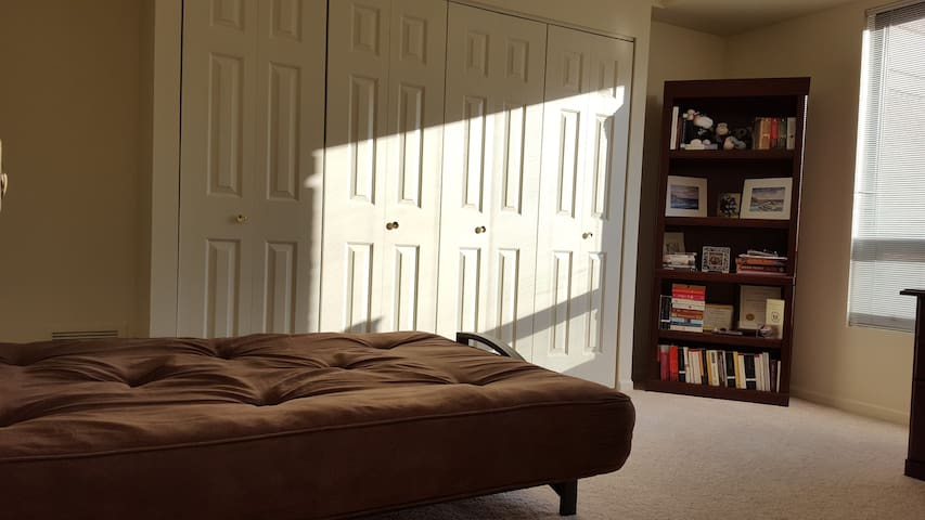 Bedroom with full sized futon