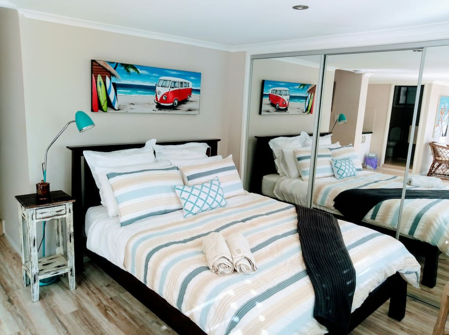The queen bed space - Luxury bed linen. Cool coastal themes to match overall living space.