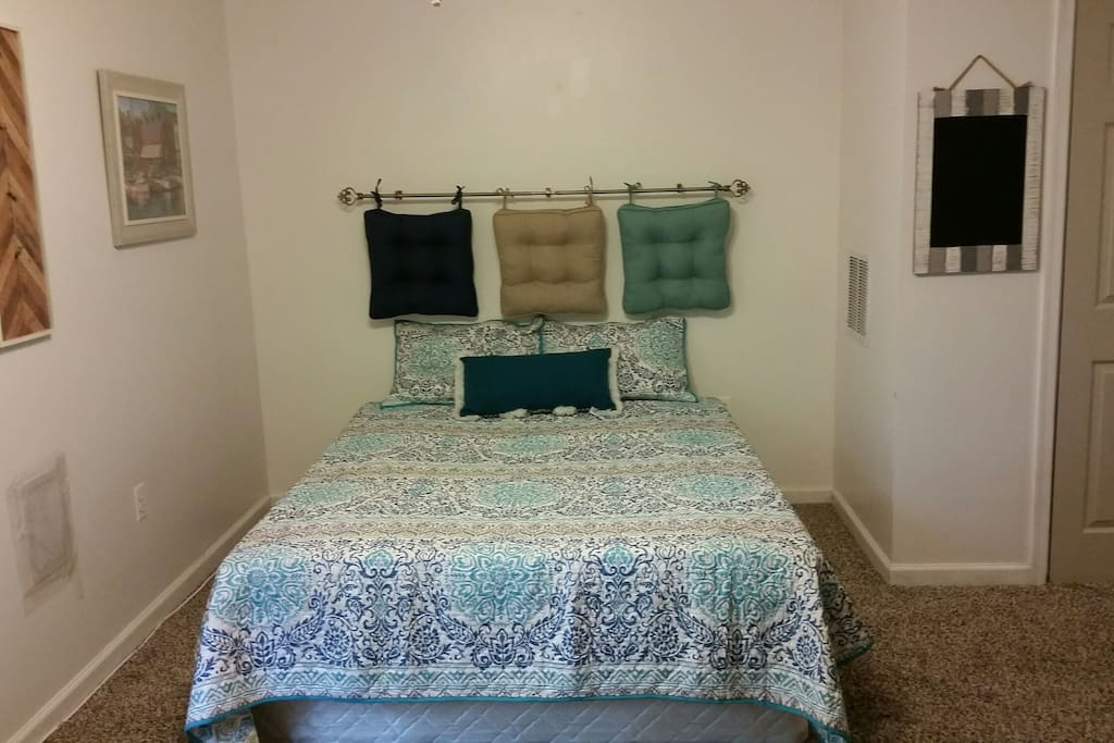 Queen size bed with foam/cooler topper