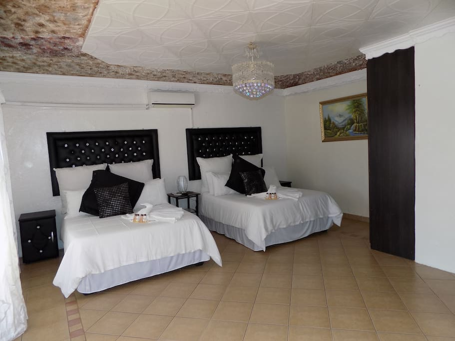 Stylish double double room ideal for four people.Dressed in white linen.Decorated in black and white.Free WiFi available.