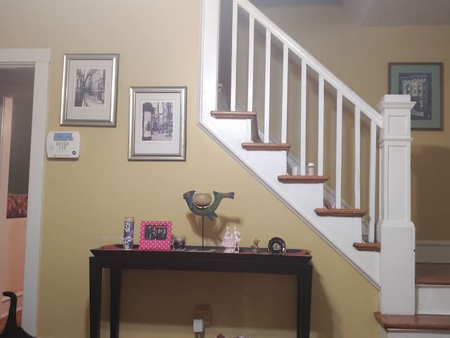 Living room décor with stairs