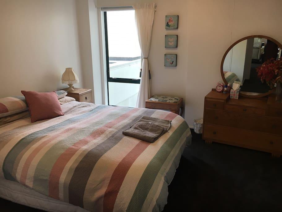 Main bedroom with a queen