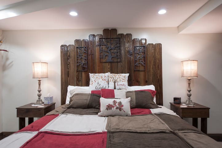 King size bed with night tables with charging ports.