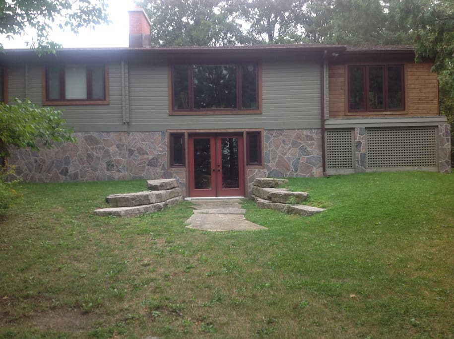 Front of cottage seen from lake, walkout patio goes into basement.
