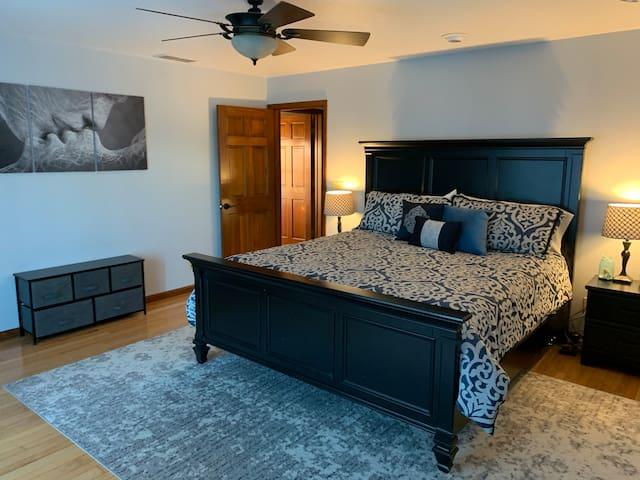 Master Bedroom-first floor. Sliding door looks out onto lake and direct access to the side patio with the hot tub.
