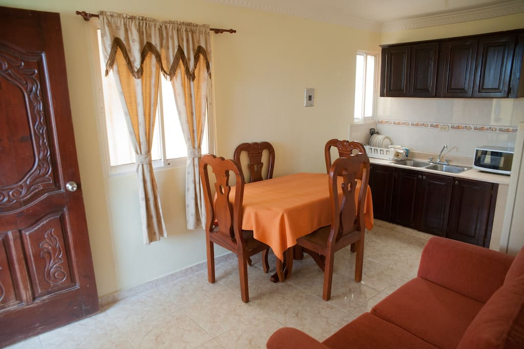 Dining, living room. Equipped kitchen and kitchenware