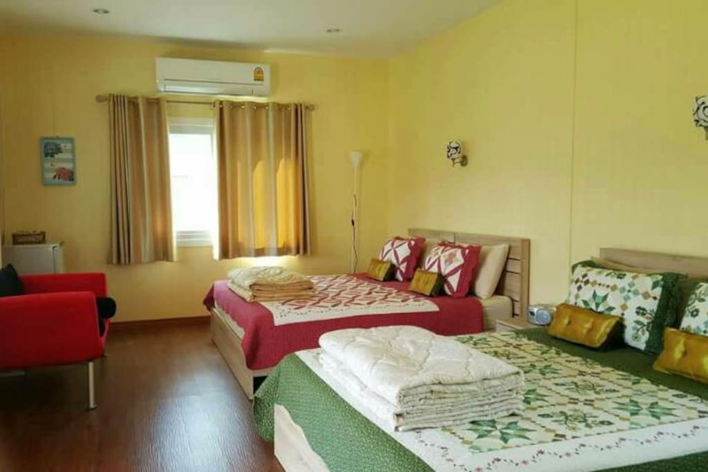 room with 2 beds &  bathroom