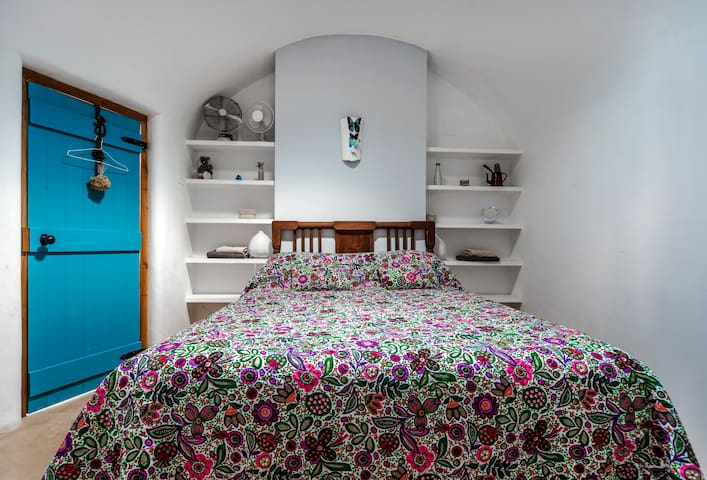 Large double bed in a beautiful dome with light well