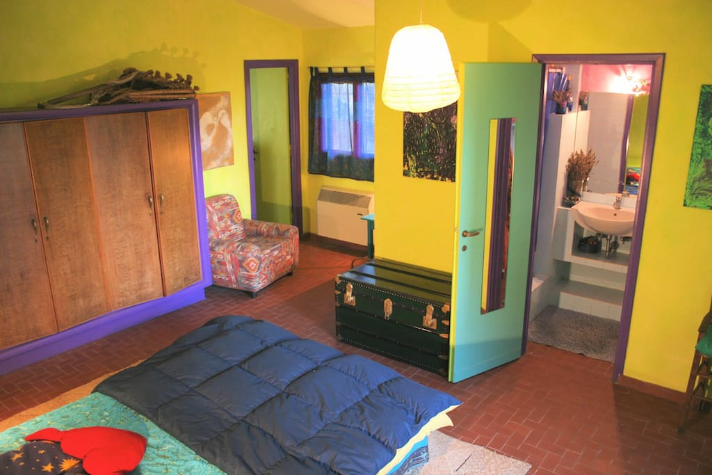 your cozy, colored, artistic bedroom in the two-rooms independent part of the house