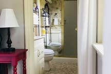 Private bathroom with large walk in tiled shower.