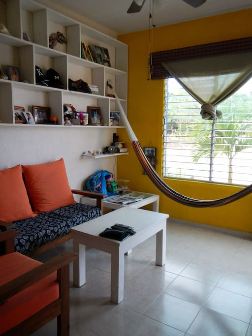 Living room.  Hooks for at least 3 hammocks.  Two chairs, love seat.  Jungle breezes via the front window.  Basic and comfy!