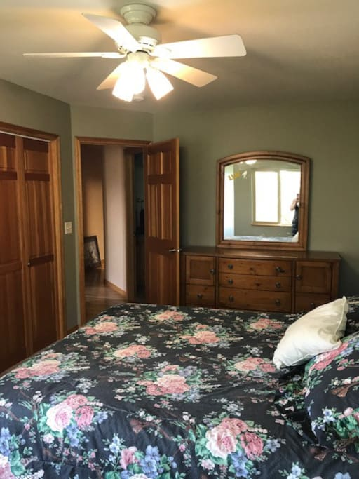 Spacious room w/ closest and dresser space.