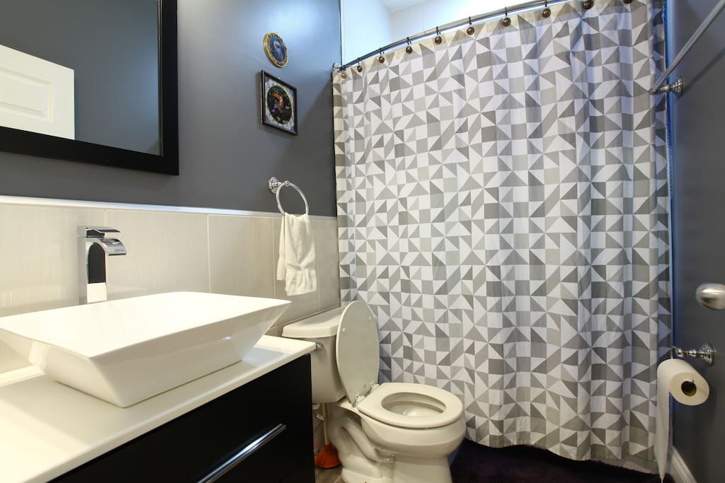 Enjoy your FULLY private en-suite master bathroom with tub and shower and top-of-the-line Moen and Hansgrohe fixtures.  Your bathroom comes with body wash, shampoo, Cottonelle toilet paper, generous quantity of bath towels, hand towels and wash cloths, as well as a hair dryer.