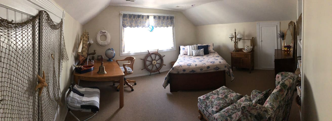 Nautical room.  Full size bed. Sleeps 2 guests
