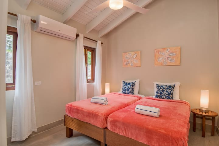 one of the two twin bedded rooms